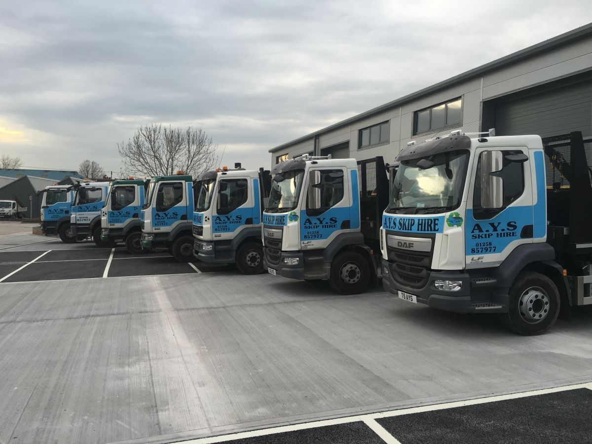 Fleet of 7 AYS Skip Hire delivery trucks