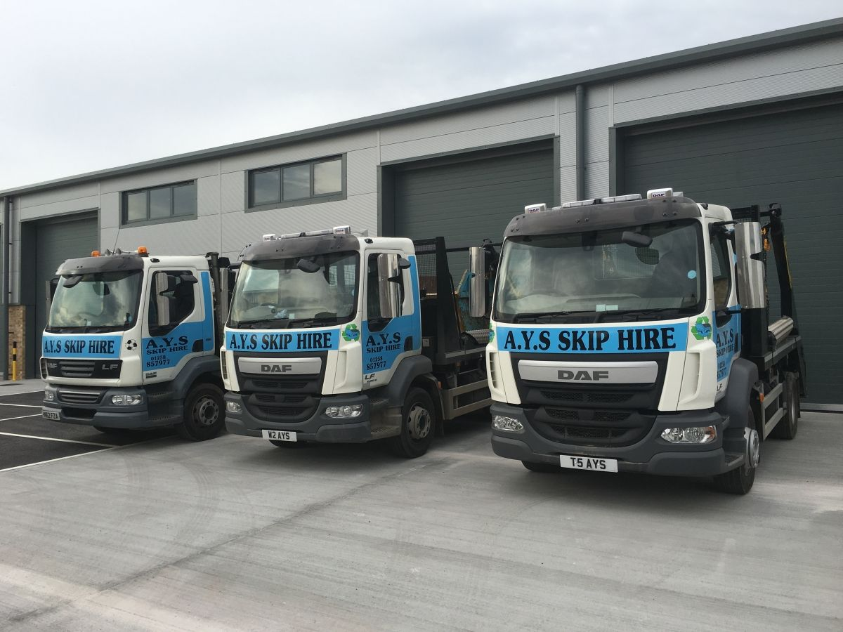 3 of our Skip Delivery Trucks