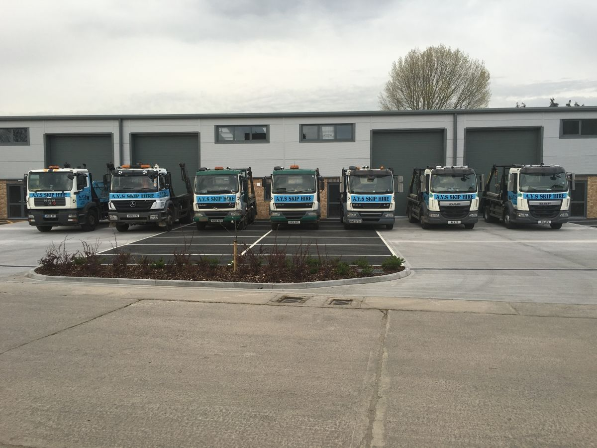 7 of Our Skip Trucks in a Row