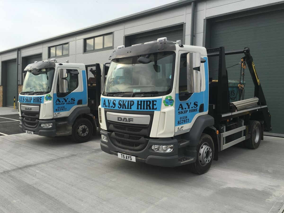 Two of Our Skip Trucks