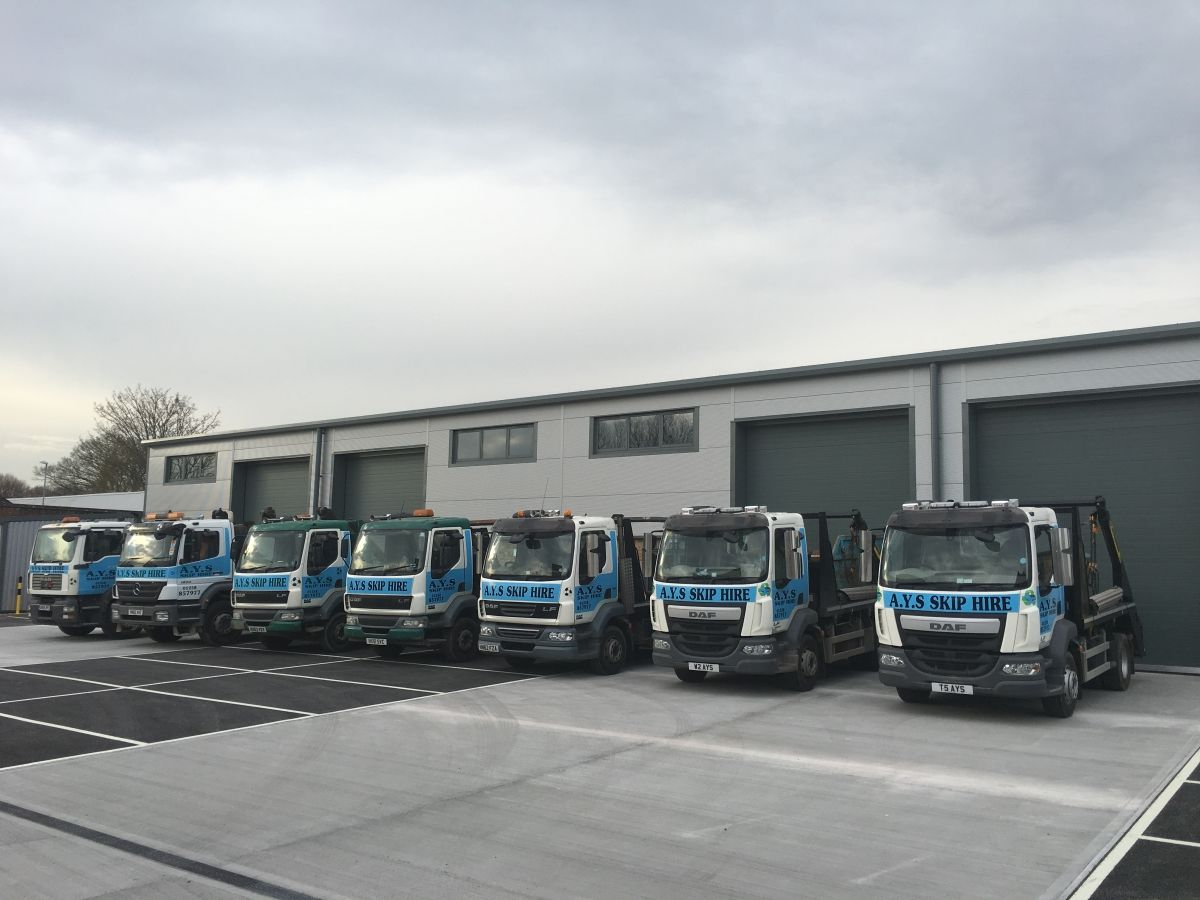 Line up of Our Skip Delivery Trucks